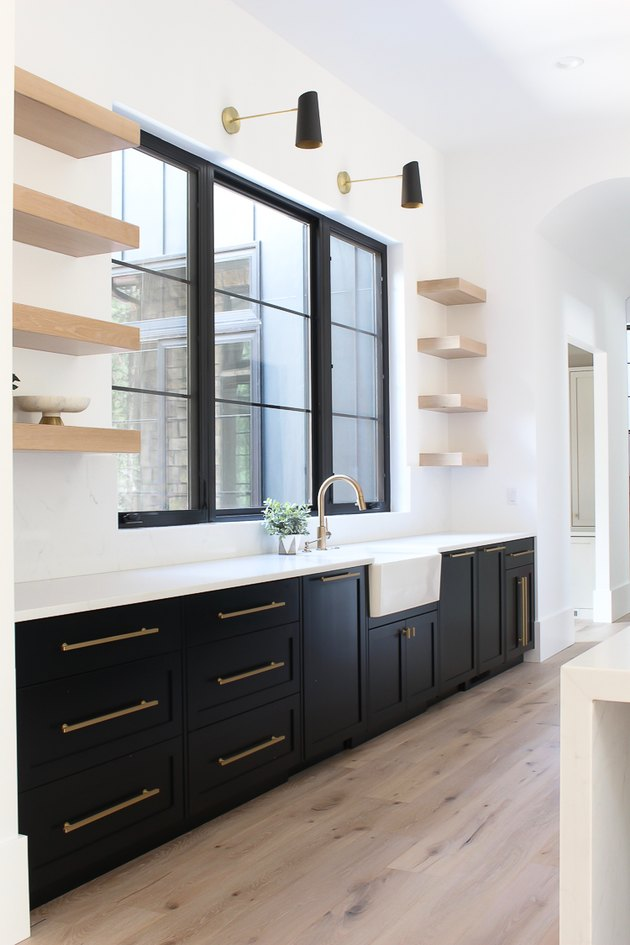 kitchen cabinet hardware idea with black cabinets and open shelving