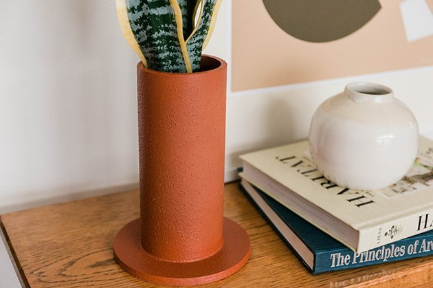 Faux terra cotta vase with snake plant.