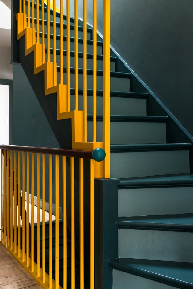 painted stairs with yellow handrail teal steps