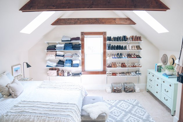 A-frame bedroom shelving idea with open shelving for clothes and shoe storage