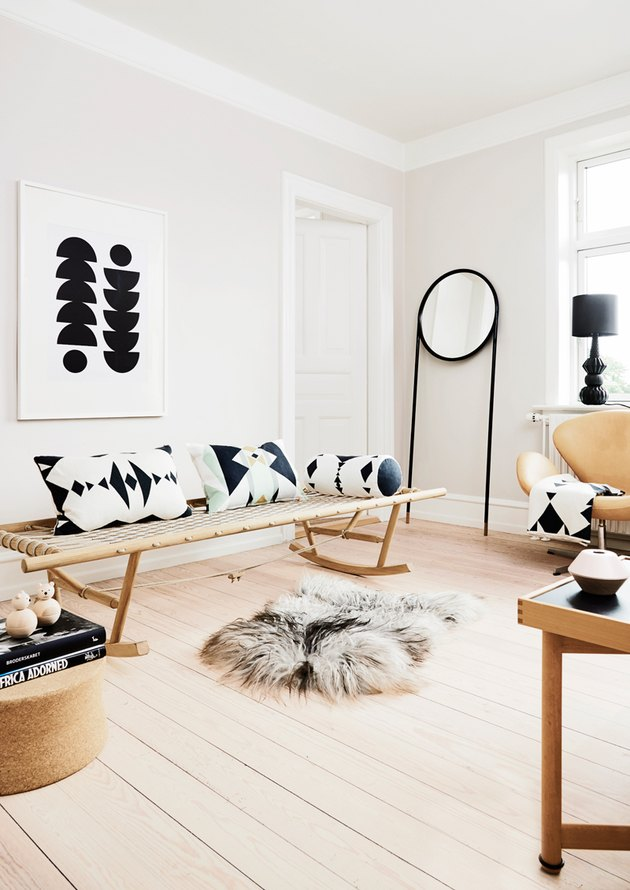 Scandinavian-inspired daybed in the living room idea with rocking daybed and patterned throw pillows