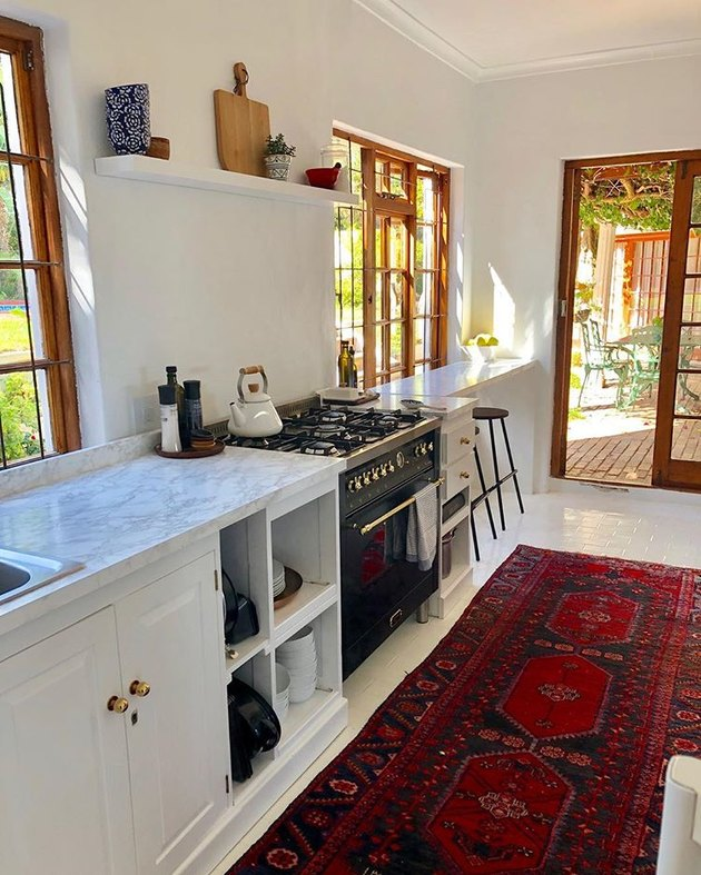 marble contact paper for countertops in kitchen with red rug