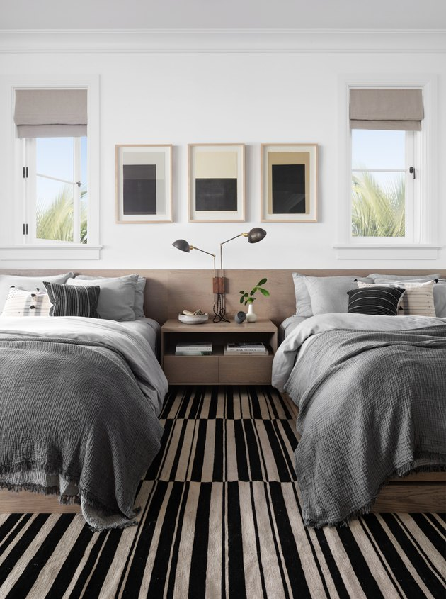 black and white bedroom idea with striped carpet and single nightstand