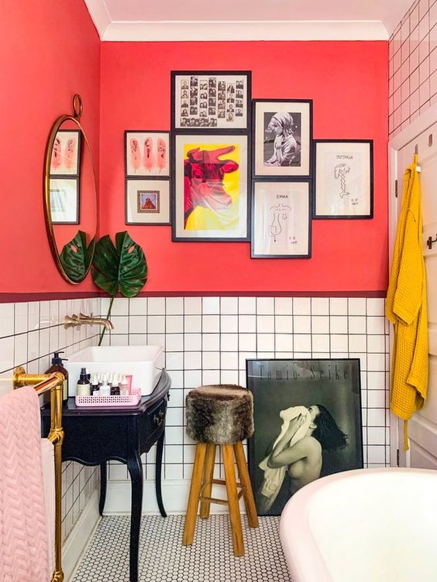 bathroom design idea with bright pink walls and vintage sink cabinets