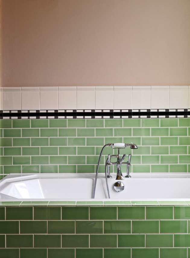 bathroom design idea with pink and green vintage tiles with silver taps