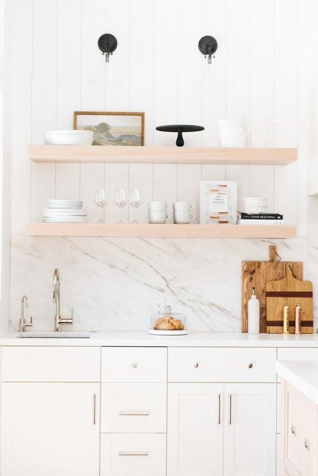 kitchen backsplash idea with marble and tile with open shelving
