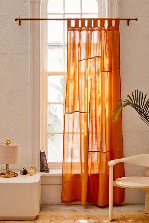 bedroom curtain idea with orange gauze curtains in boho master bedroom