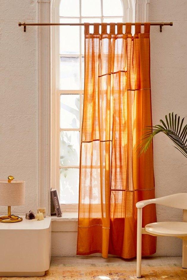 bedroom curtain idea with orange gauze curtains in boho master bedroom