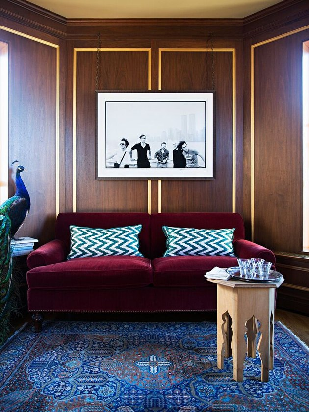 living room sofa ideas with wood paneling on the walls and velvet sofa