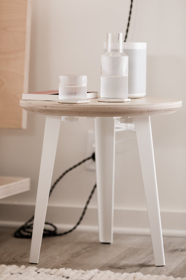 birch plywood side table with glass carafe and speaker