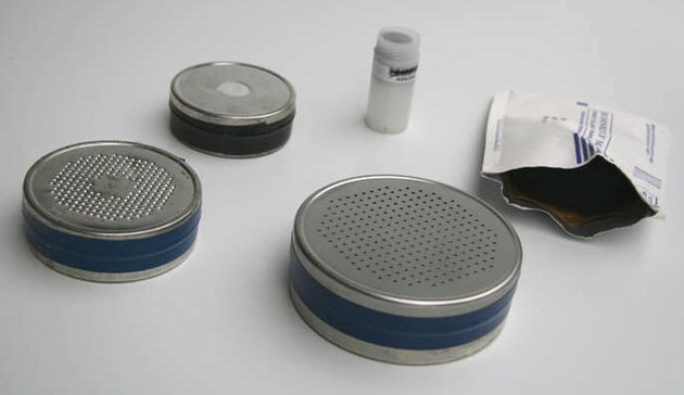 Several different forms of charcoal canister detectors