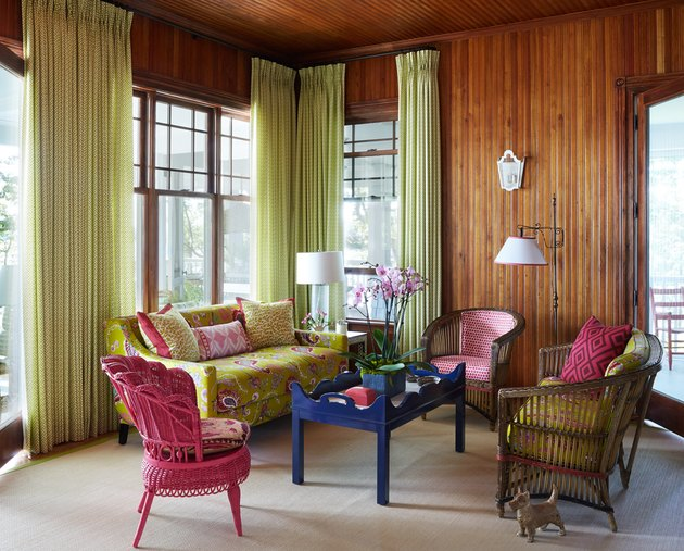 living room sofa ideas with bright pops of color and green drapery