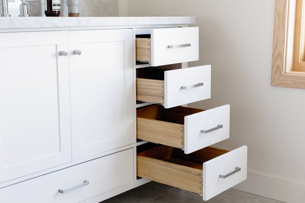 bathroom vanity with open drawers