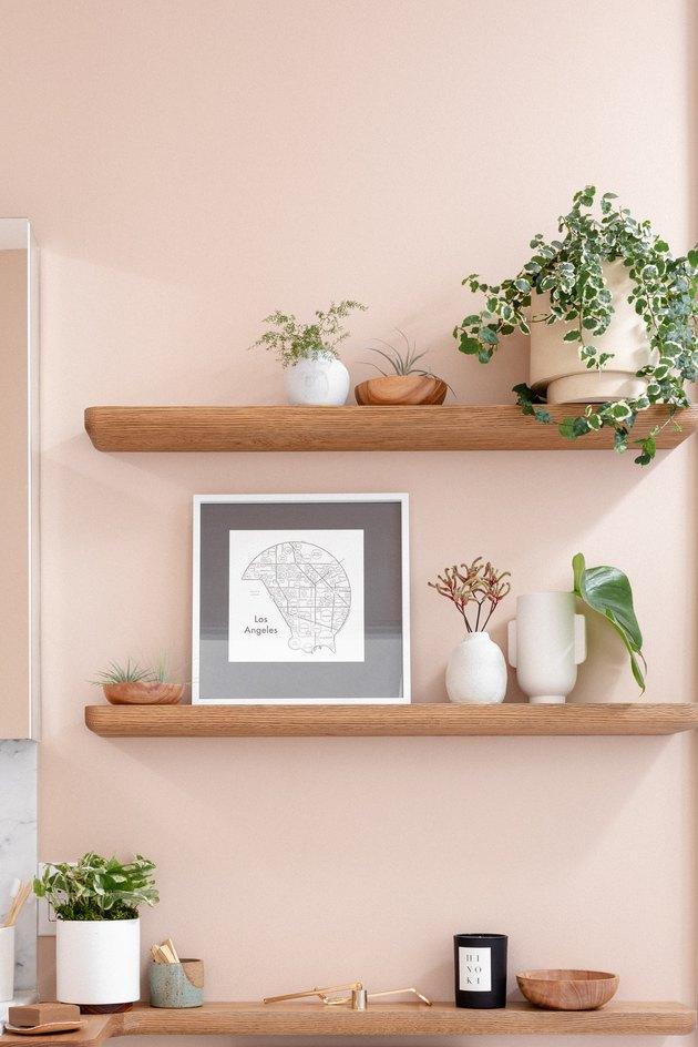bathroom shelves on a light pink/salmon wall