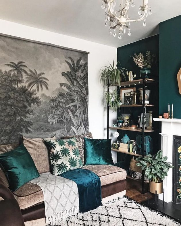 botanical living room wall decor idea with illustrated wall hanging