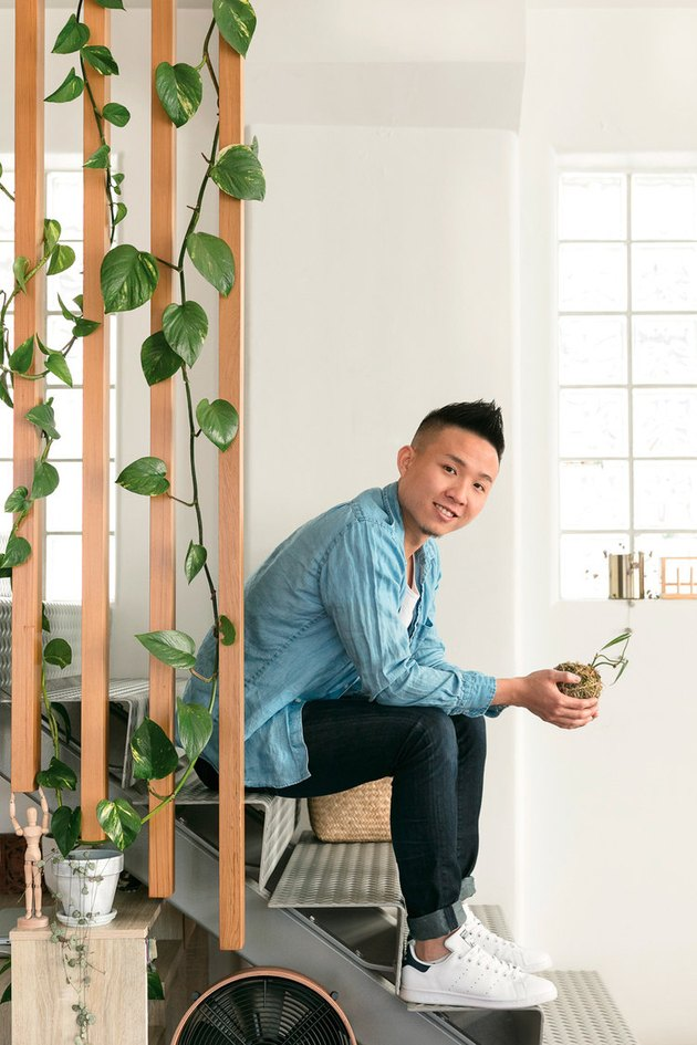 Ron Goh sitting on stairs in loft