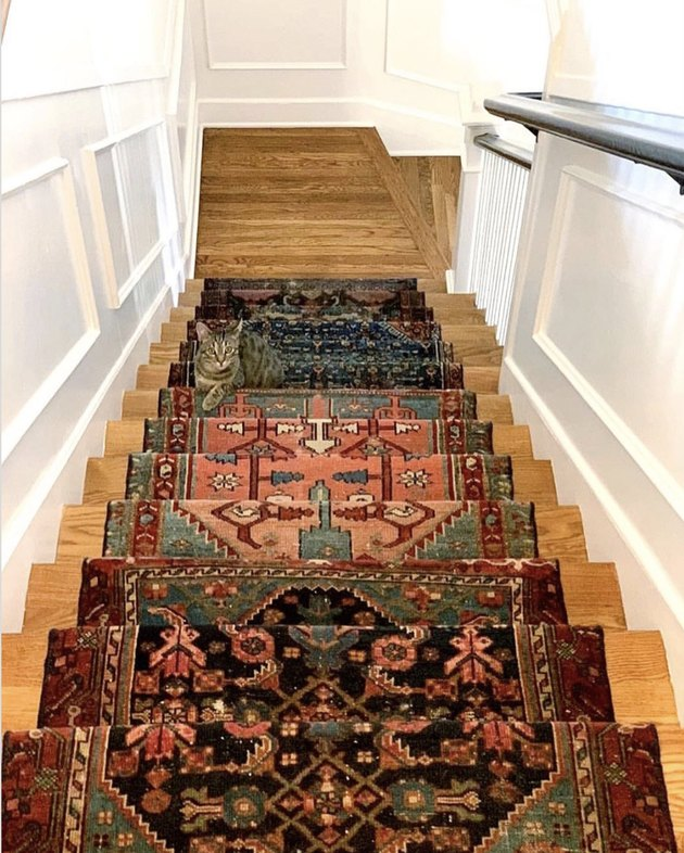 Persian rug stair runners on wood stairs
