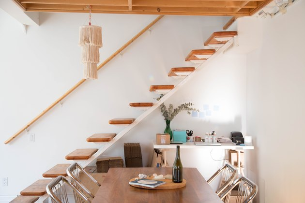 floating staircase idea with wood stair railing