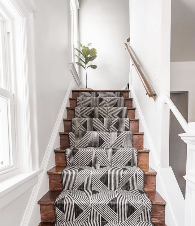 Boho geometric stair runners with fiddle leaf fig tree on dar wook stairs
