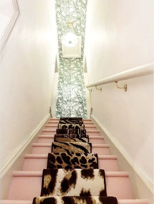 Leopard-print stair runners on top of pink stairs