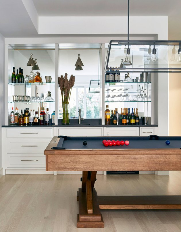 basement wall ideas with bar shelves and pool table