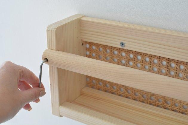 Screwing cane shelf to wall