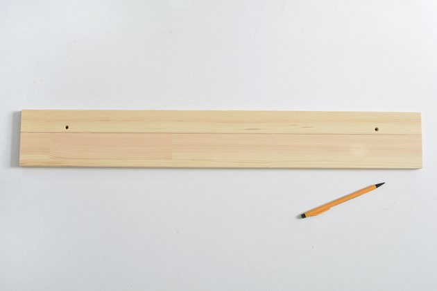 Wooden shelf with cut line drawn in pencil