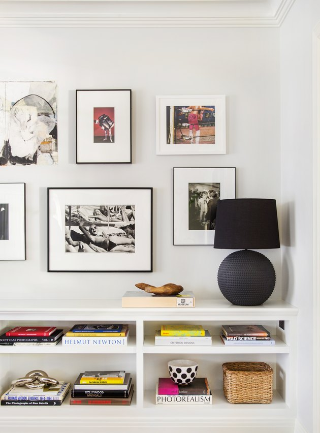 Gallery wall basement wall ideas with white console and black lamp