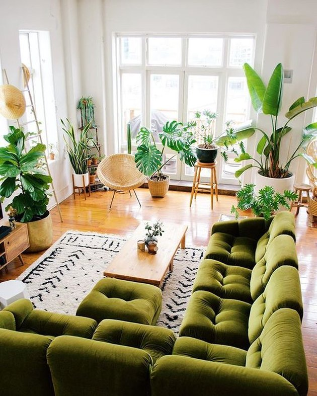 Ron Goh of Mr. Cigar Loft living room with green sectional sofa