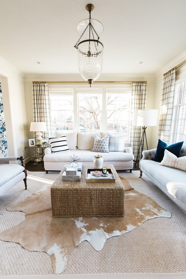 cream traditional living room with sofas and woven coffee table