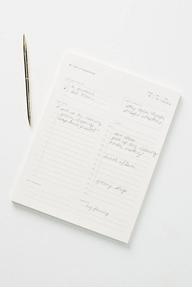 notepad with pen nearby