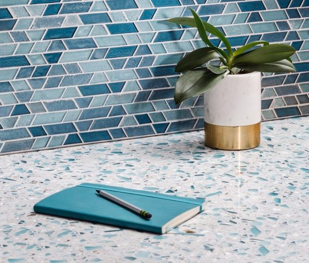 Blue and white speckled quartz countertop colors, blue shades glass backsplash tile.