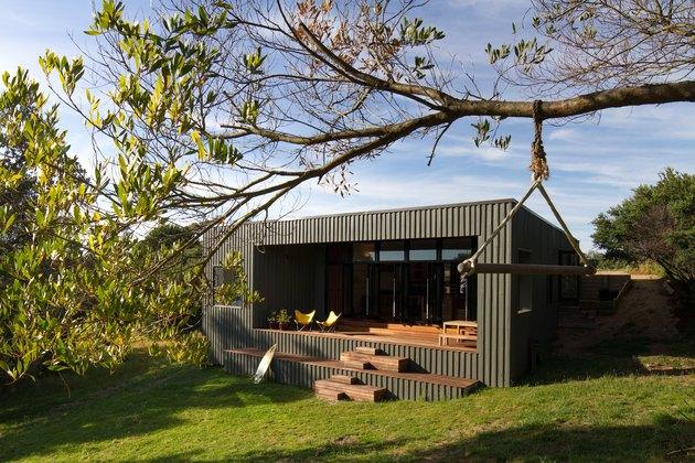 boxy house exterior near trees