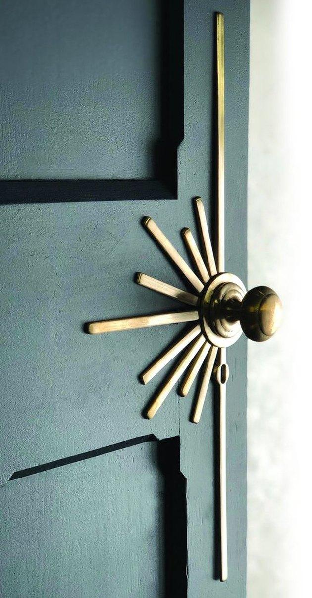 Art deco door in green with brass sunburst hardware