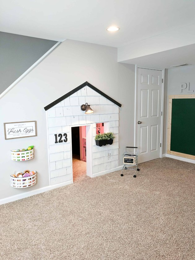 Basement Playroom Ideas with playhouse and chalkboard