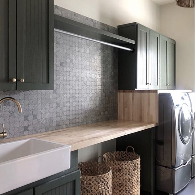 basement laundry room ideas with washer and dryer and green cupboards.