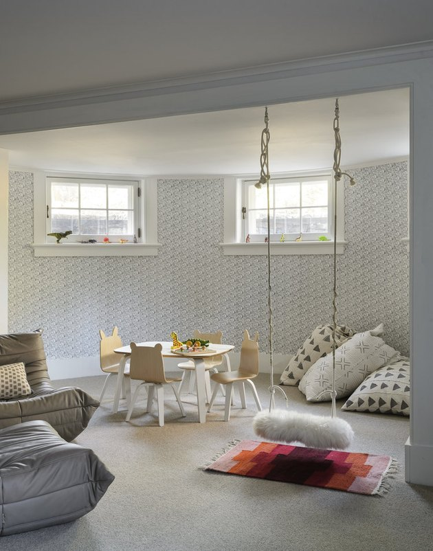 Basement Playroom Ideas with swing and floor pillows