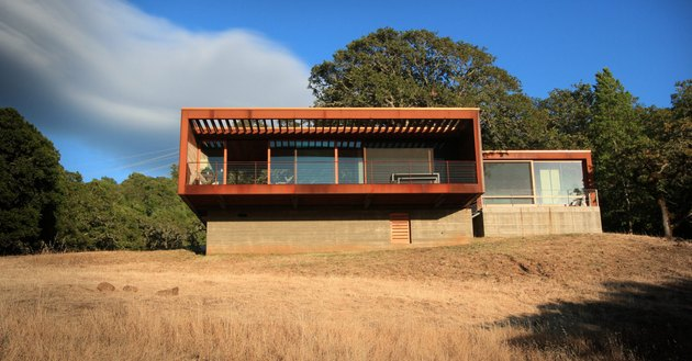 boxy house exterior on raised platform