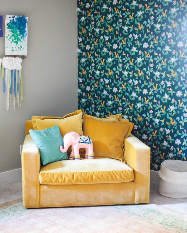 Basement Playroom Ideas with colorful wallpaper and yellow chair