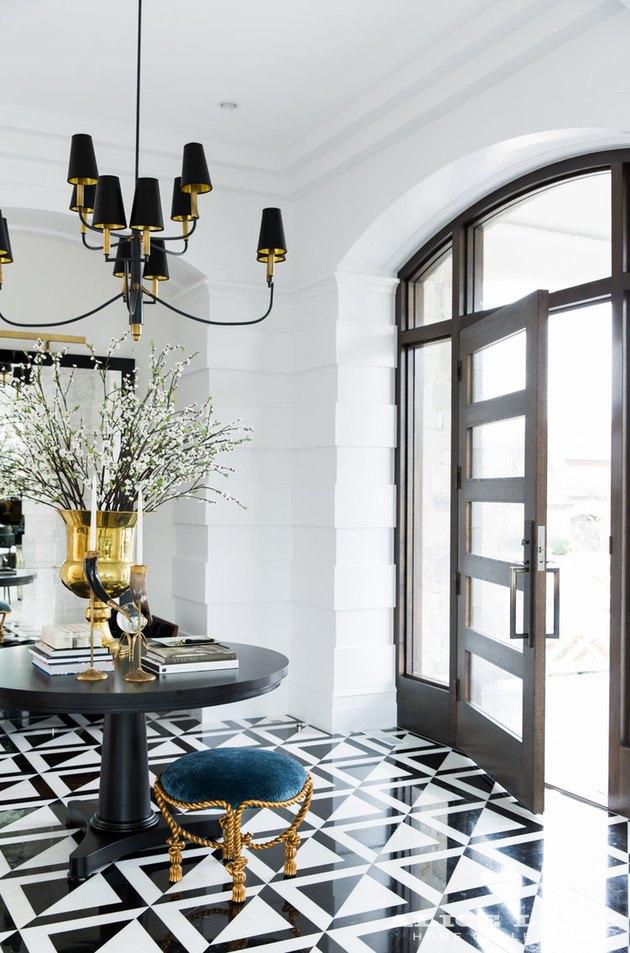 Art deco door with geometric windows and art deco entryway