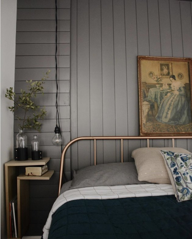 moody gray neutral colors in bedroom with shiplap and pendant light