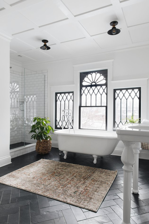 traditional home decor in bathroom with clawfoot tub and decorative windows