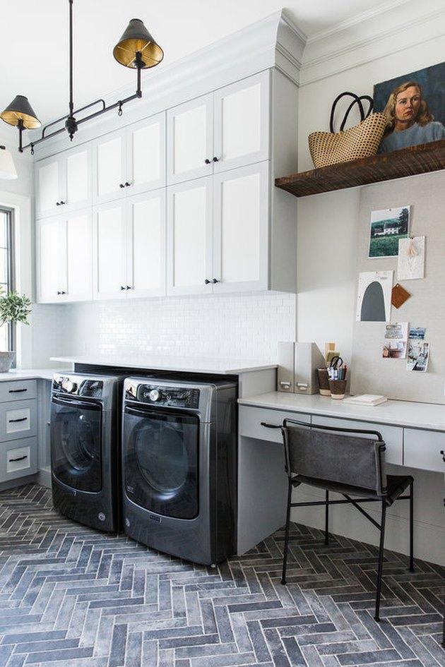 basement laundry room ideas hexagon pattern brick floor and black ceiling light in