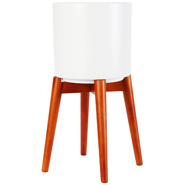 White mid-century-inspired planter with long wooden legs