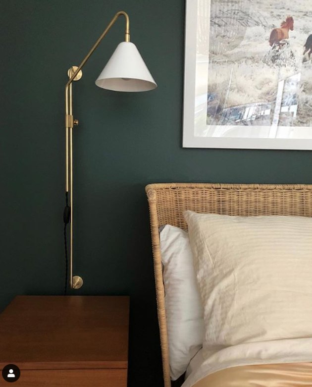 bedroom lighting ideas with French pole light wall sconce next to woven headboard