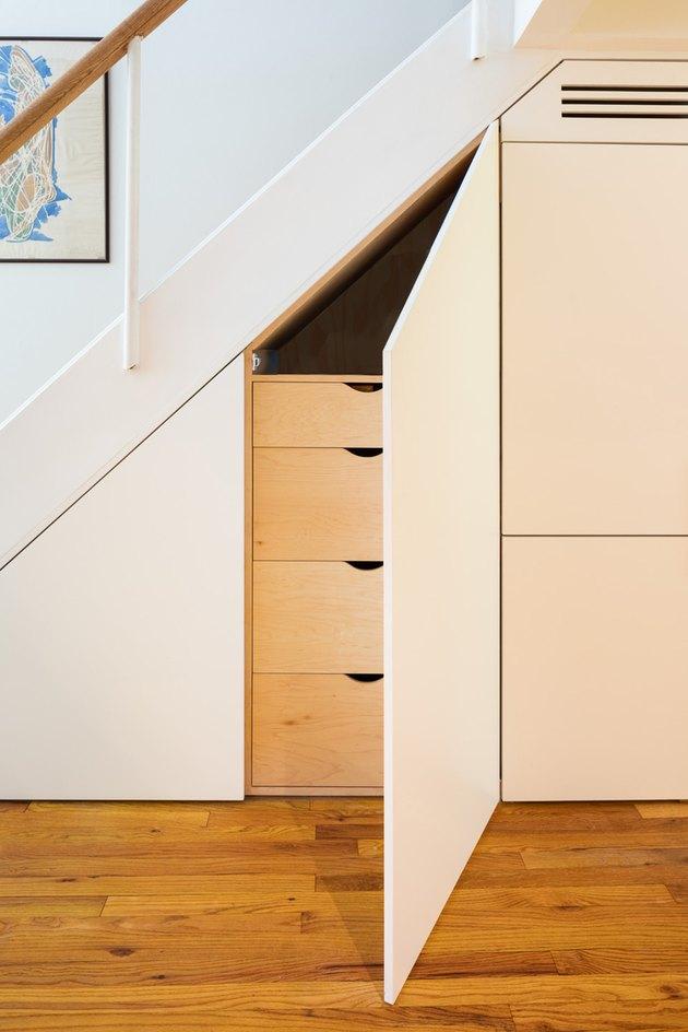 built in storage under stairs