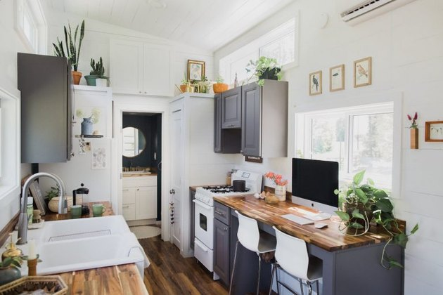 modern tiny house with gray cabinets in kitchen