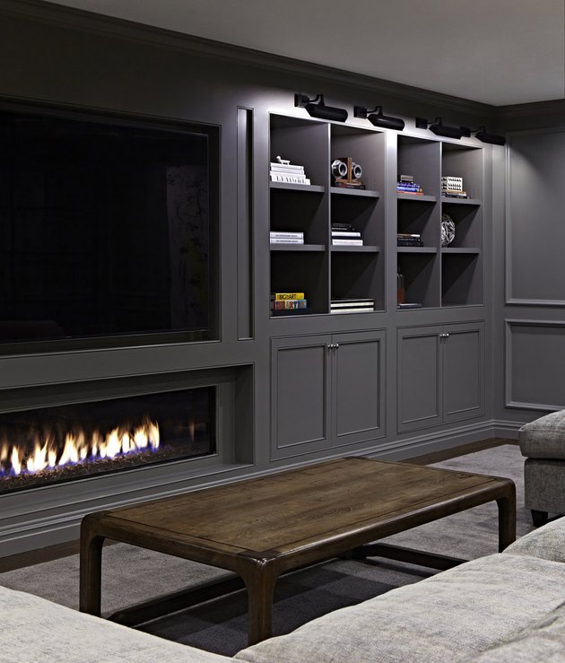 gray basement paint colors in basement with fireplace and mounted TV