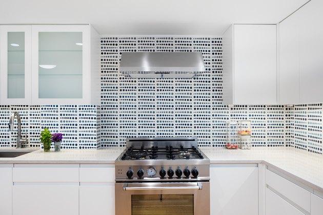 white kitchen with patterned tile backsplash