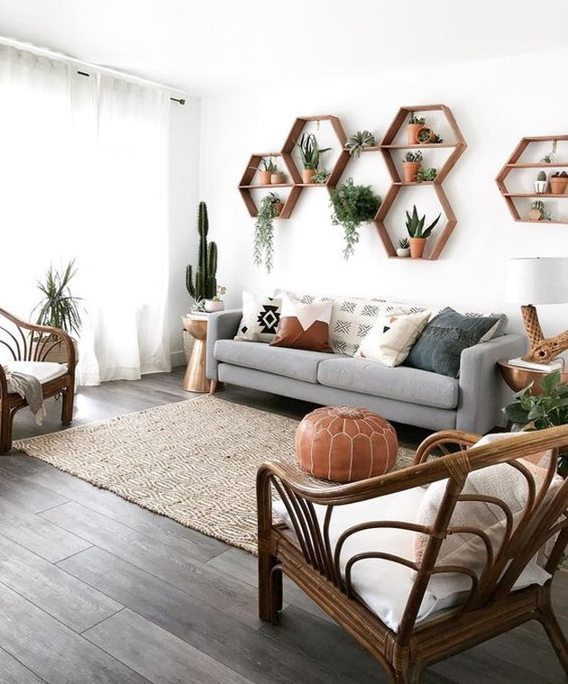boho living room wall decor idea with hexagonal shelves and plants
